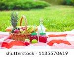 picnic basket  fruit  juice in... | Shutterstock . vector #1135570619