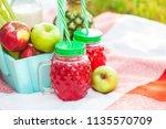 picnic basket  fruit  juice in... | Shutterstock . vector #1135570709