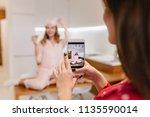 charming european woman fooling ... | Shutterstock . vector #1135590014