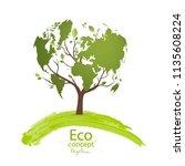 green globe on the tree. tree... | Shutterstock .eps vector #1135608224