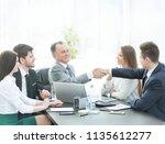 businessman and investor shake...   Shutterstock . vector #1135612277