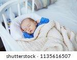 adorable baby girl sleeping... | Shutterstock . vector #1135616507