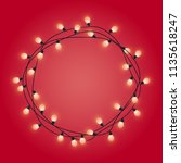 garland frame with glowing... | Shutterstock .eps vector #1135618247