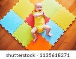 happy smiling baby girl lying... | Shutterstock . vector #1135618271
