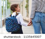 first day at school. mother... | Shutterstock . vector #1135645007