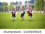 happy children girls girlfriend ... | Shutterstock . vector #1135645025