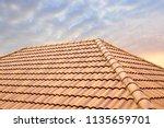 roof tiles and sky sunlight...   Shutterstock . vector #1135659701