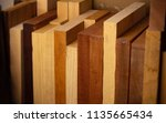 thick wooden planks resting on... | Shutterstock . vector #1135665434
