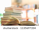 close up of books opened on... | Shutterstock . vector #1135697204