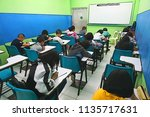 young students studying on... | Shutterstock . vector #1135717631