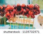 japanese bbq grill octopus... | Shutterstock . vector #1135732571