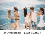 group of caucasian guys and... | Shutterstock . vector #1135762574