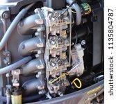 four carburetors  intake... | Shutterstock . vector #1135804787