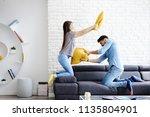 young hispanic couple sitting... | Shutterstock . vector #1135804901