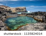 Rock Pool In Foreground With...