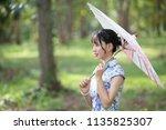 beautiful asean woman in the... | Shutterstock . vector #1135825307