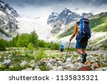 climbers with hiking backpacks... | Shutterstock . vector #1135835321