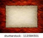 Paper sheet on red rough wall background - stock photo
