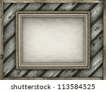 Picture frame on wood background - stock photo