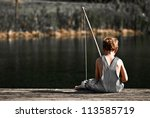Boy Fishing In Overalls From A...