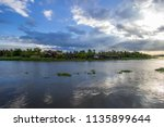 beautiful sun beams and sky... | Shutterstock . vector #1135899644