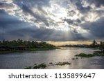 beautiful sun beams and sky... | Shutterstock . vector #1135899647