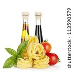 Italian colors food. Basil, pasta, tomatoes, olive oil and vinegar. Isolated on white background - stock photo