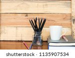 notebook with crayon color... | Shutterstock . vector #1135907534