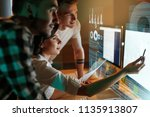 programmers working on software ... | Shutterstock . vector #1135913807