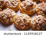 homemade pastry with a topping... | Shutterstock . vector #1135918127