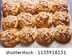 homemade pastry with a topping... | Shutterstock . vector #1135918151
