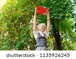 student schoolgirl happy with... | Shutterstock . vector #1135926245