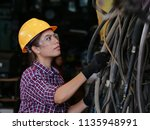 young asian engineer woman ... | Shutterstock . vector #1135948991