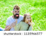 child and father posing with... | Shutterstock . vector #1135966577