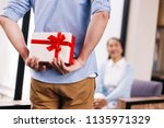 middle aged husband hiding a...   Shutterstock . vector #1135971329