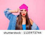 Small photo of I am princess and number one here! Close up studio photo portrait of pretty lovely coquet charming excited lady making v-sign near eyes looking at you camera isolated bright color pastel background