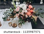 banquet table is decorated with ... | Shutterstock . vector #1135987571