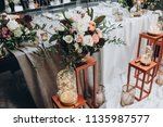 in banquet hall next to table... | Shutterstock . vector #1135987577