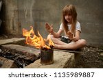 neglected lonely child warming... | Shutterstock . vector #1135989887