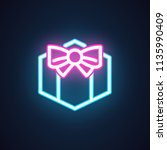 gift box with bow neon icon.... | Shutterstock .eps vector #1135990409