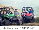 friends driving off road with... | Shutterstock . vector #1135995431