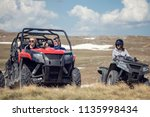 friends driving off road with... | Shutterstock . vector #1135998434