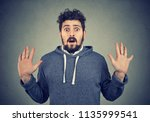 young bearded man in hoodie... | Shutterstock . vector #1135999541
