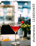 red cosmopolitan cocktail with... | Shutterstock . vector #1136014655
