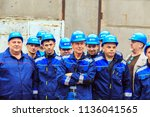 group of  builders in hardhats. ... | Shutterstock . vector #1136041565