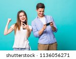 attractive young couple are... | Shutterstock . vector #1136056271