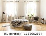 real photo of a cozy bedroom... | Shutterstock . vector #1136062934