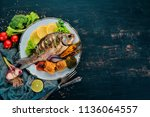 baked fish carp. on a wooden... | Shutterstock . vector #1136064557
