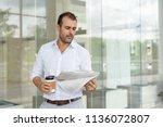 focused businessman concerned... | Shutterstock . vector #1136072807