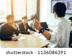 business person holding pen and ... | Shutterstock . vector #1136086391